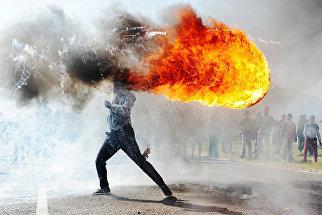 Протесты в г. Грабу (ЮАР). Работа фотографа Фандулвази Джайкло из ЮАР