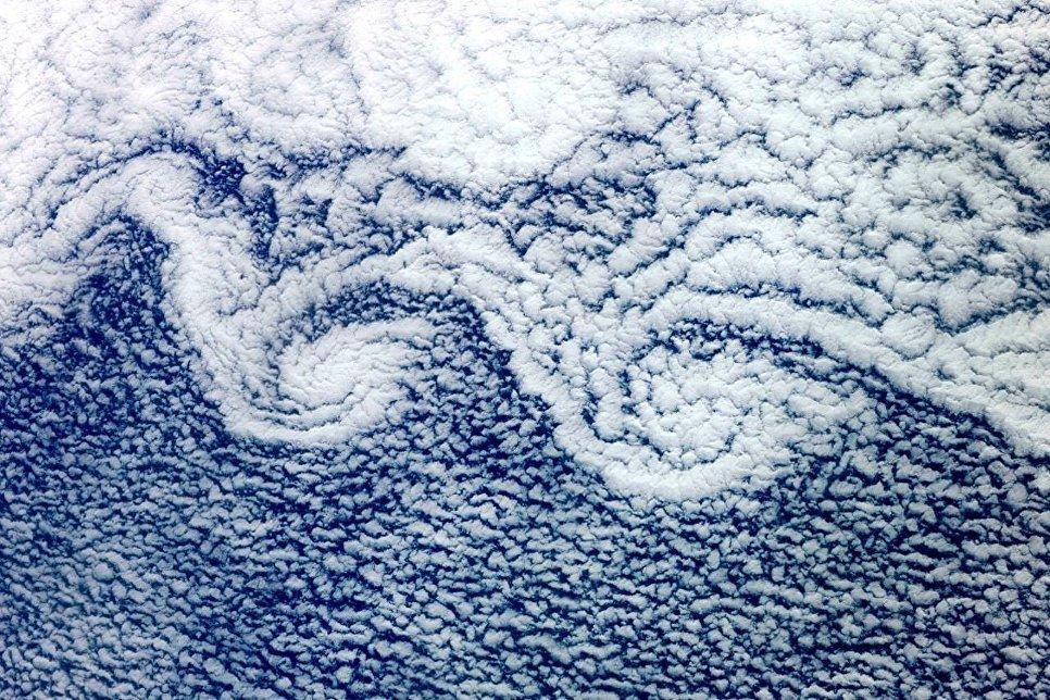 Снимок облаков на Земле снятый космонавтом Фёдором Юрчихиным с борта МКС