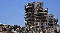Разрушенные здания в квартале Кабун в пригороде Дамаска. Архивное фото