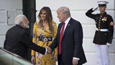 Президент США Дональд Трамп, первая леди Меланья Трамп и премьер-министром Индии Нарендра Моди в Вашингтоне. 26 июня 2017