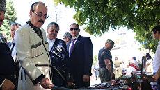 Глава Дагестана Рамазан Абдулатипов на фестивале народных промыслов и культуры в Дагестане. Архивное фото