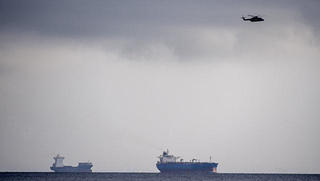 Поисковый вертолет над районом моря близ Копенгагена, где затонула частная подводная лодка Nautilus. 11 августа 2017