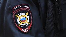 Нашивка на рукаве сотрудника полиции. Архивное фото