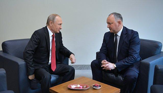Президент РФ Владимир Путин и президент Республики Молдова Игорь Додон. Архивное фото