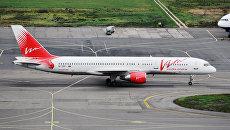 Пассажирский самолет Боинг 757 авиакомпании ВИМ-авиа в аэропорту Домодедово. Архивное фото