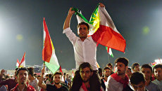 Сторонники независимого Иракского Курдистана на Фестивале независимости на стадионе Франсо Харири в Эрбиле. Архивное фото
