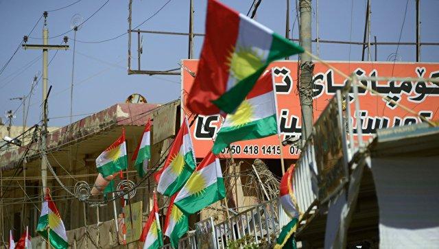 Агитационные плакаты, призывающие прийти на участки и проголосовать на референдуме о независимости Иракского Курдистана от Багдада, в Эрбиле. Архивное фото