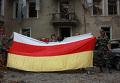 Сотрудники цхинвальского ГУВД отыскали флаг страны в разрушенном здании милиции