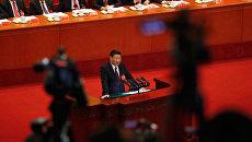 Си Цзиньпин выступает на открытии 19-го съезда Коммунистической партии Китая. 18 октября 2017
