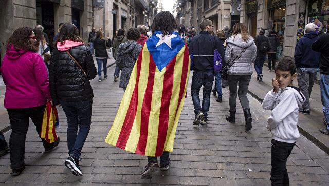 Участники всеобщей забастовки в Каталонии во время стачки в Барселоне. Архивное фото