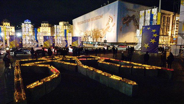 Участники акции в Киеве, посвященной годовщине начала событий на Майдане. Архивное фото
