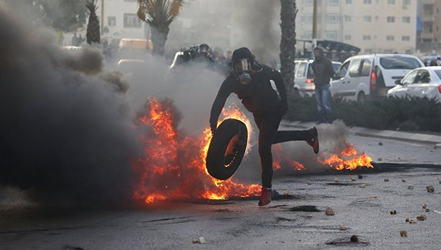 Участник акции протеста в Палестине против решения о признании Иерусалима столицей Израиля. 7 декабря 2017