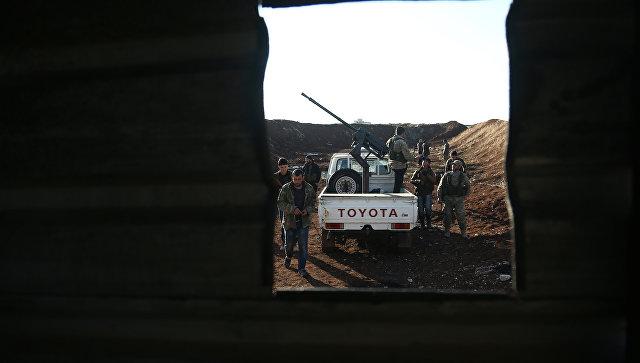 Турецкие военные из Свободной сирийской армии на позиции курдов в районе Африн. 20 января 2018
