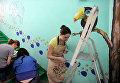 Художники-волонтеры расписывают стены сюжетами русских народных сказок в отделениях Морозовской детской больницы