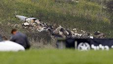 На месте крушения израильского истребителя F-16, участвовавшего в налете на Сирию. Архивное фото