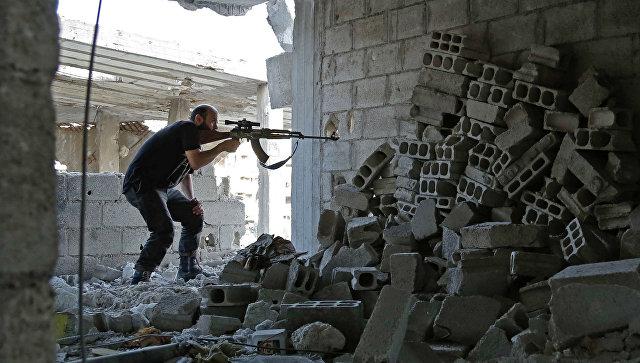 Боевик из группировки Файлак-ар-Рахман в Восточной Гуте, Сирия. Архивное фото
