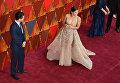 Американская актриса Джина Родригес и Джо Локисеро на премии Оскар-2018