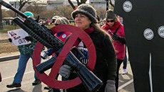 Участница Марша за наши жизни в Вашингтоне с требованием ужесточить контроль за оборотом огнестрельного оружия. 24 марта 2018