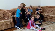 Верная клятве дагестанка стала мамой для восьмерых детей-сирот с ОВЗ