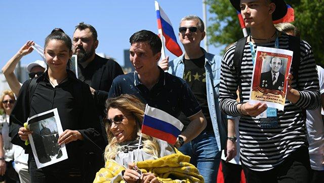 Участница 63-го международного конкурса песни Евровидение - 2018 от России Юлия Самойлова во время акции Бессмертный полк в Лиссабоне. 6 мая 2018