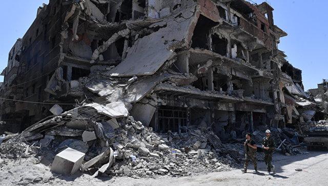Разрушенные дома в освобожденном лагере палестинских беженцев Ярмук на юге Дамаска