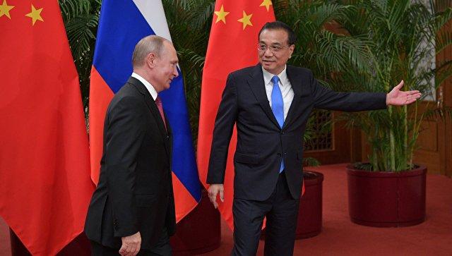Китай готов наращивать объемы торговли с Россией, заявил Ли Кэцян
