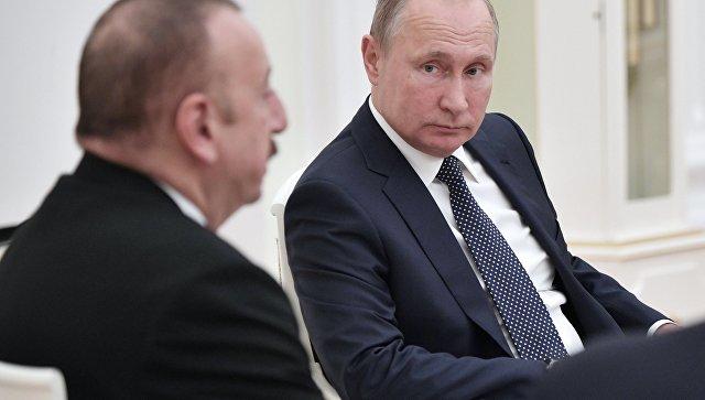 Владимир Путин и президент Азербайджана Ильхам Алиев во время встречи. 13 июня 2018