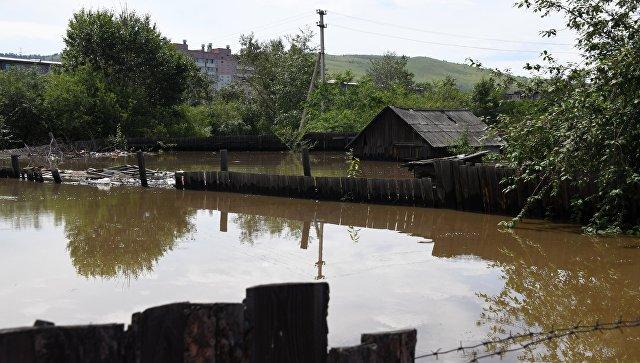 Затопленный паводком дом. Архивное фото