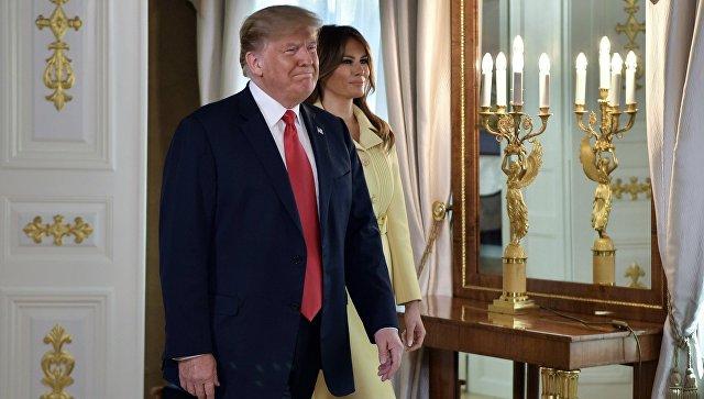 Президент США Дональд Трамп с супругой Меланьей во время встречи с президентом РФ Владимиром Путиным в президентском дворце в Хельсинки. 16 июля 2018