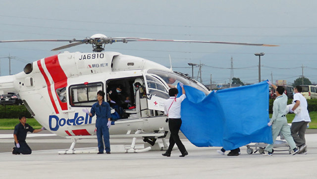 Спасательная операция для членов экипажа вертолета, разбившегося в городе Маэбаси, префектуры Гумма, Япония. 10 августа 2018