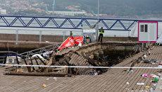Участок обрушение деревянной платформы на набережной испанского города Виго во время концерта. 13 августа 2018