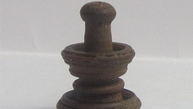 Шахматная фигурка, найденная во время археологических раскопок на Старом замке в Гродно. Архивное фото