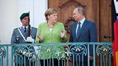 Президент России Владимир Путин и канцлер Германии Ангела Меркель во время встречи в Гранзе, Германия. 18 августа 2018