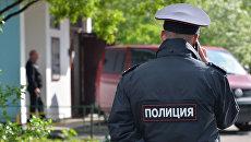 Сотрудник полиции на месте преступления. Архивное фото