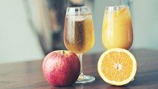 Яблочный и апельсиновый сок. Архивное фото