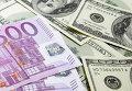 Денежные купюры. Доллары США. Евро