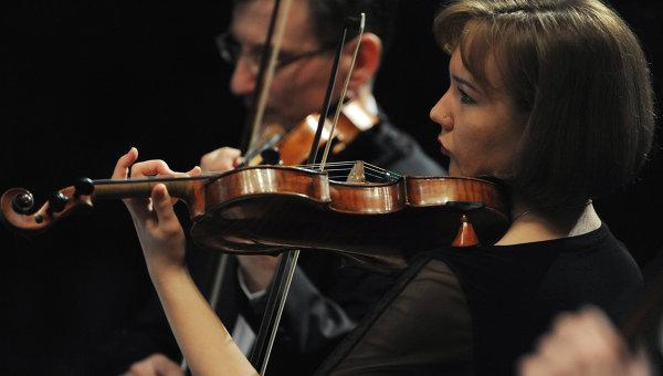 Музыканты Большого симфонического оркестра во время концерта