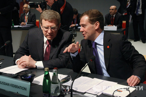 Президент России Дмитрий Медведев и заместитель председателя правительства РФ - министр финансов РФ Алексей Кудрин