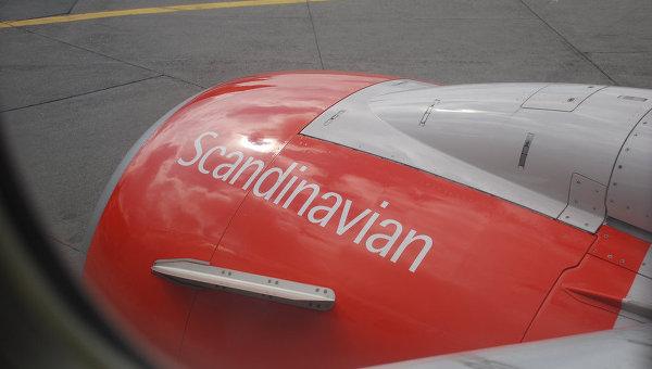 Вид из иллюминатора принадлежащего SAS Airlines самолета. Архивное фото