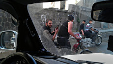 Повстанцы патрулируют улицы в Сирии. Архивное фото