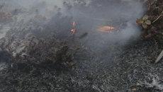 Ветер со снегом раздули лесной пожар на Колыме