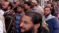 Длинные очереди к телу Муамара Каддафи выстроились в Мисрате