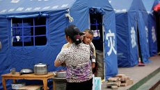 Палаточный лагерь недалеко от эпицентра землетрясения, произошедшего в провинции Сычуань на юго-западе Китая