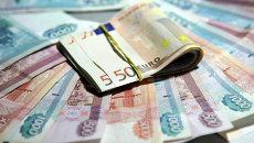 Рубли и евро, архивное фото