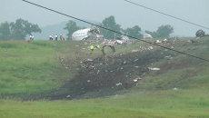 Выжженный след остался на холме после падения Airbus 300 в Алабаме